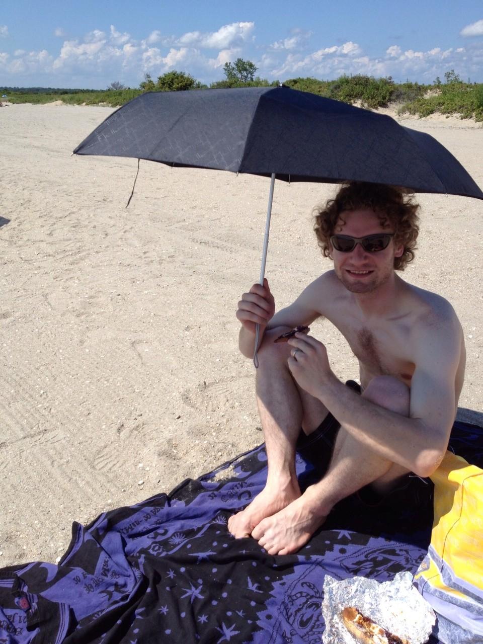 Photo of Big Mr. demonstrating the original use of the umbrella