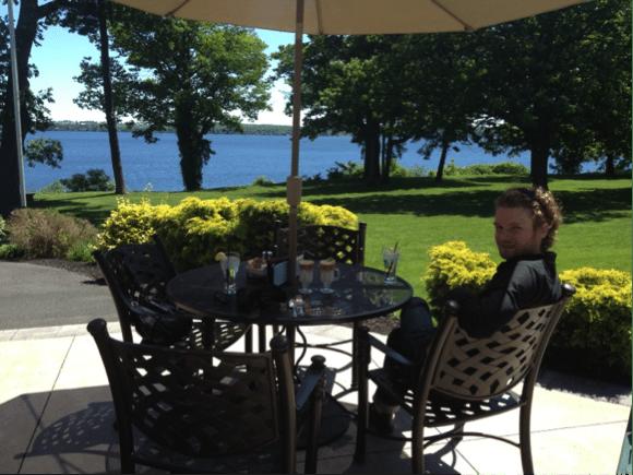 Big Mr. sitting at picnic table by lake