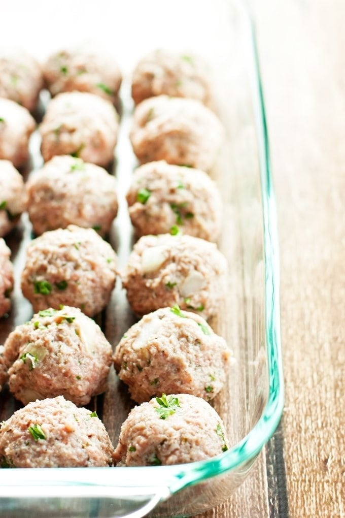 baked turkey meatballs in pan ready to be cooked