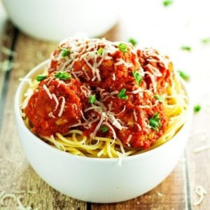 baked turkey meatballs served over spaghetti and topped with homemade tomato sauce and parmesan cheese
