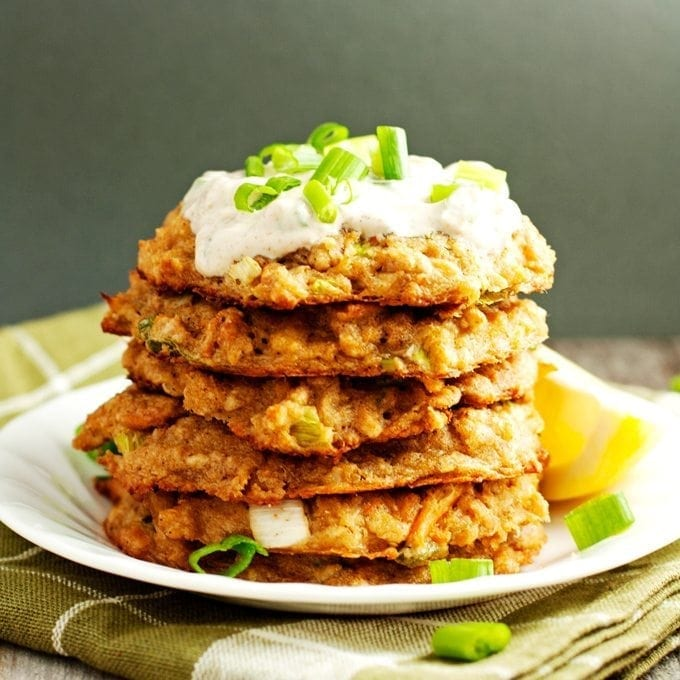 stack of baked crab cakes with yogurt sauce