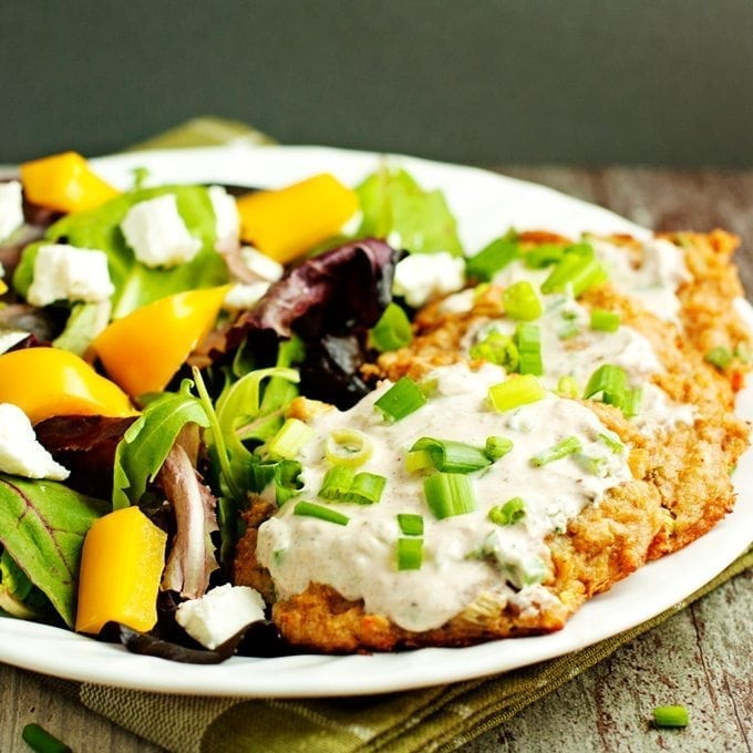 Baked crab cakes served with salad.