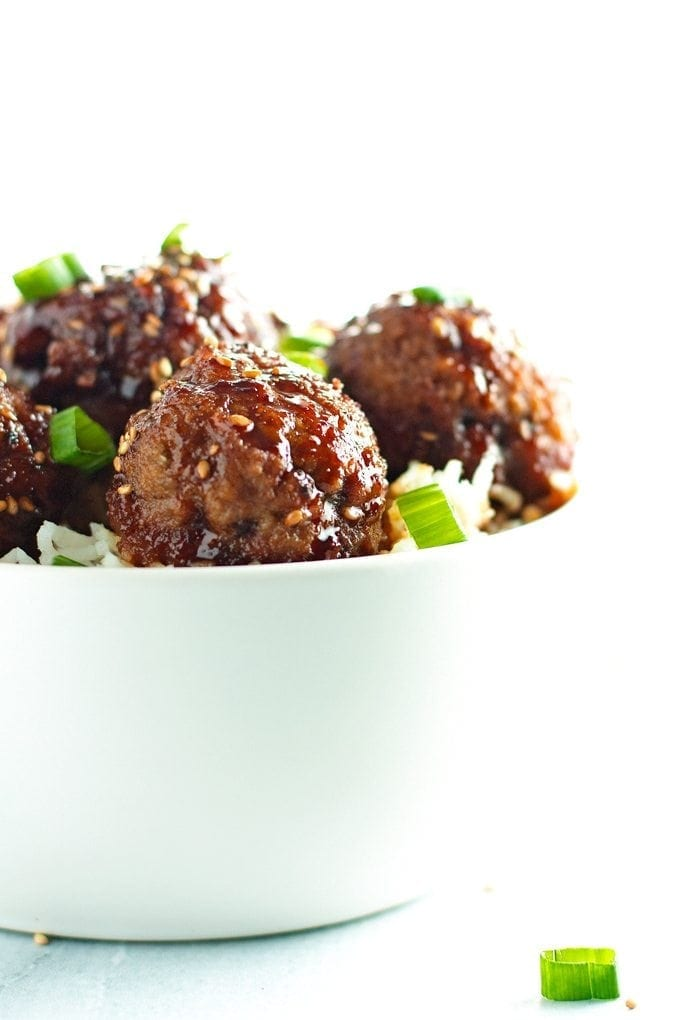 straight on shot of bowl full of beef teriyaki meatballs.