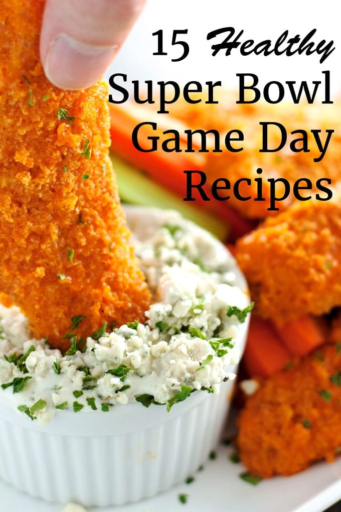 healthy super bowl game day recipes, baked buffalo chicken tender dipped in blue cheese